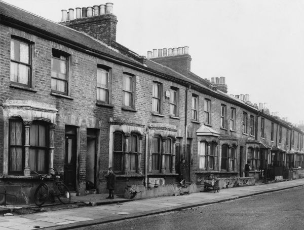 A row of Victorian terraced houses in an East London street, due for demolition
