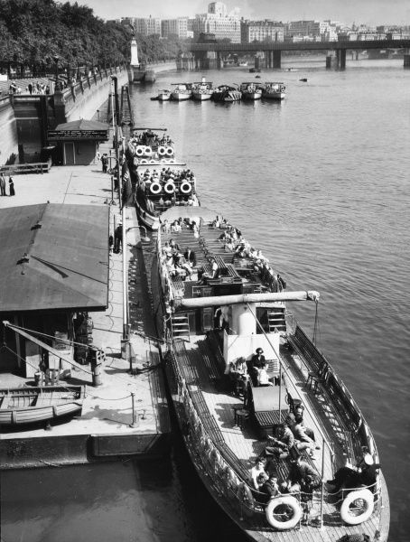 Tourist vessels with seats on deck, moored at Westminster Pier, London
