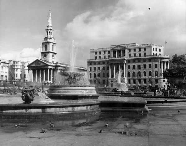 The South African Embassy building, South Africa House, and St. Martin-in-the-Fields Church, Trafalgar Square, central London. Date: 1960s