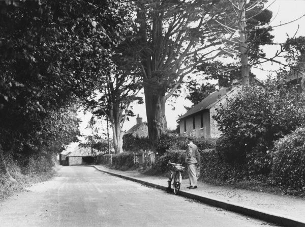 A gentleman and his bicycle in Sussex