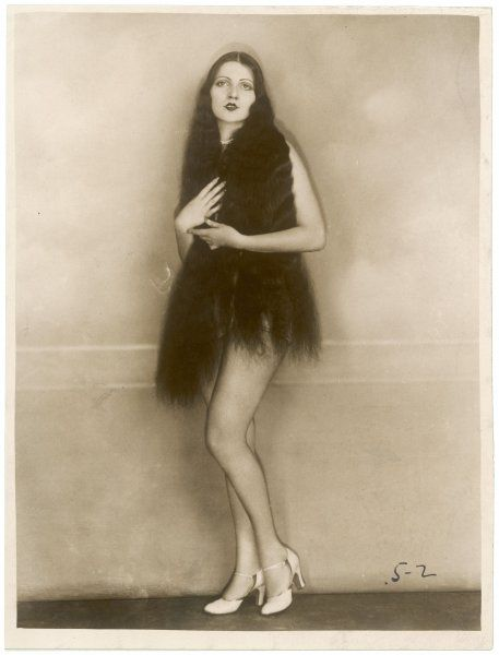 The extremely long dark hair of Miss Margaret Mayer of the Ziegfeld Follies