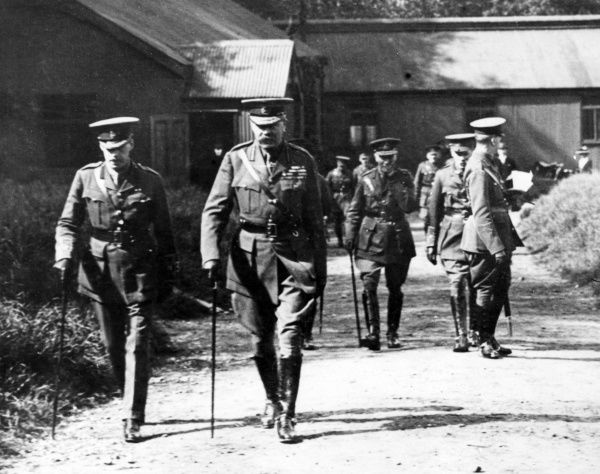 Lord Herbert Kitchener (1850-1916) (centre) with other officers at a Royal Engineer Cadets training centre, during the First World War. Date: circa 1914-1916