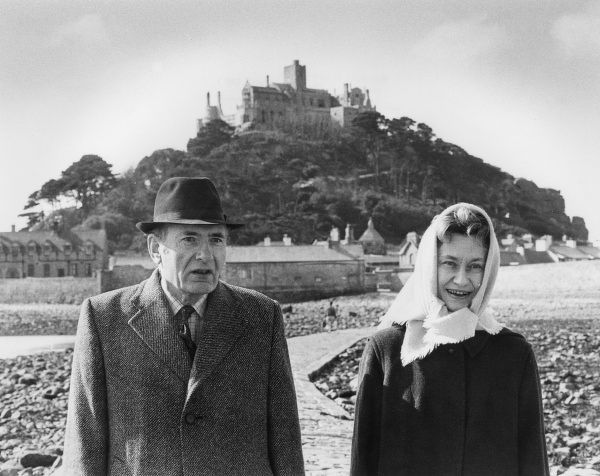 Lord John Francis Arthur St Aubyn, 4th Baron St Levan (b 1919), and his wife Lady Susan St Levan (d 2003), walk along the causeway from their home on St Michael's Mount, Cornwall