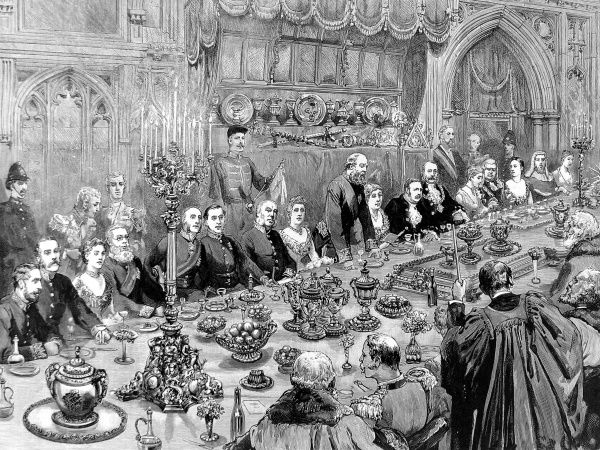 Banquet scene at London's Guildhall. An annual banquet is traditionally held to celebrate the mayor's installation in November each year. The Lord Mayor can be seen seated on a lavishly carved chair, six places from the right of the picture