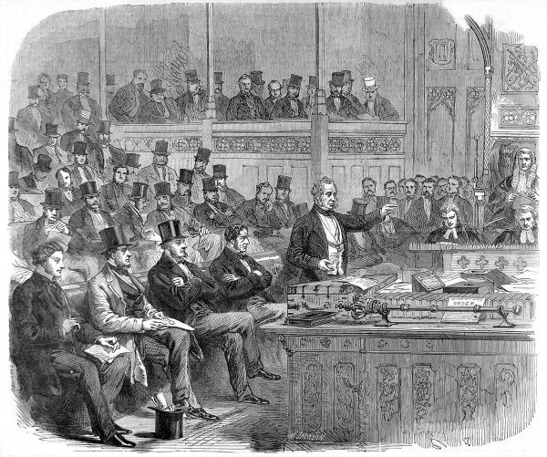 Engraving showing Henry John Temple, 3rd Viscount Palmerston (1784-1865), delivering the ministerial statement on Dano-German relations to the House of Commons, June 1864. The despatch box and mace can be clearly seen in front of him