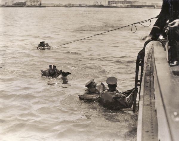 Los Angeles Harbour sea-going firemen of the LA City No.2 testing out new lifesaving suits in the water