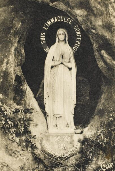 Statue of Our Lady of Lourdes, France in the Grotto at this sacred Christian site