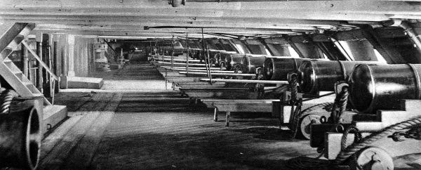 Photograph of the lower deck of HMS 'Foudroyant'; the 2nd Rate ship, built in 1798, that served as Lord Nelson's Flagship in the Mediterranean, 1799-1800. Mess tables can be seen set up between the guns