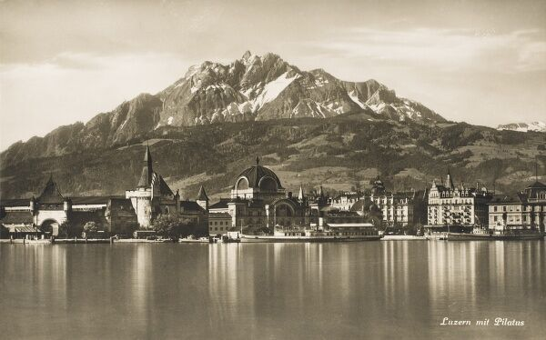 Lucerne, Switzerland with Mount Pilatus rising huge behind and Lake Lucerne in the foreground