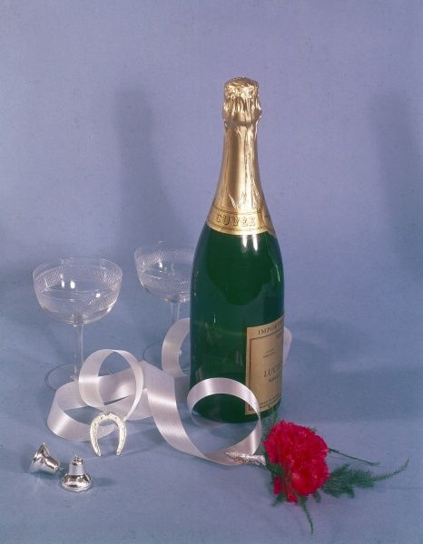 A 'lucky' horseshoe, and red roses beside a large bottle of champagne, probably meant for a couple of newlyweds to enjoy! Date: 1966