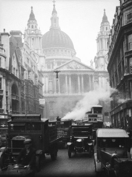 Steam and traffic jam chaos on Ludgate Hill, with St. Paul's Cathedral looming above