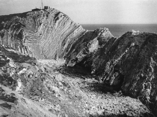 Stair Hole, Lulworth Cove, Dorset, England, showing the twisted strata formation of the rocks. Date: 1950s