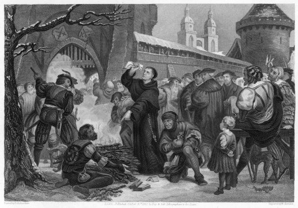 Martin Luther burns the Papal bull in front of the East gate of Wittenberg