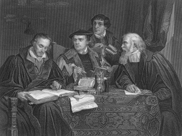 MARTIN LUTHER The German religious reformer with his associates Melancthon, Pomeranus and Cruciger. Date: circa 1525