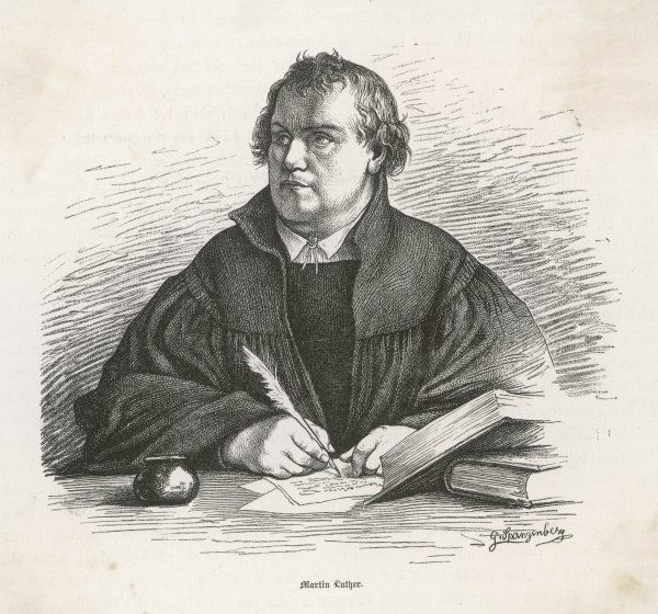 MARTIN LUTHER German church reformer, depicted writing