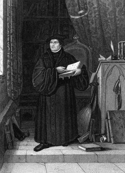 MARTIN LUTHER German church reformer, depicted in his study Date: 1483 - 1546
