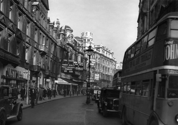 Lyric and Apollo theatres on Shaftesbury Avenue, London. The Lyric has Robert Morley and Peggy Ashcroft in Edward My Son, and the Apollo has Emlyn Williams and Mary Hinton in Trespass. Date: 1947