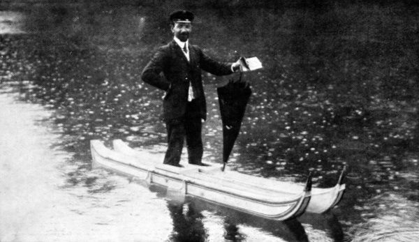Photograph of M. Remond walking on water on the lake in the Bois de Boulogne, in his experiment in 1907. He has a small canoe-like boat attached to each foot
