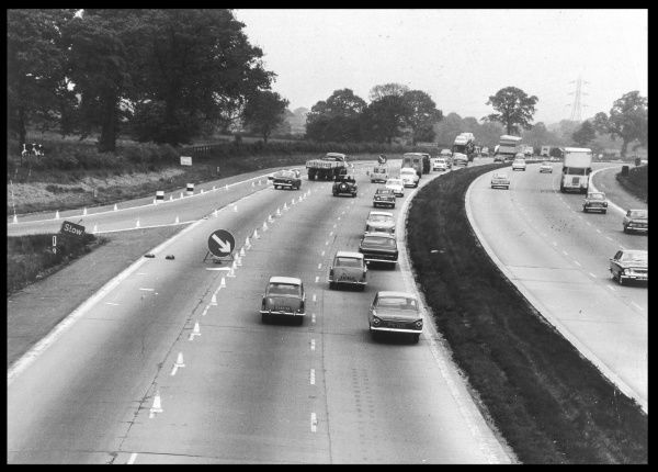 A section of the M1 motorway from London to the north : characteristically, road works are in evidence