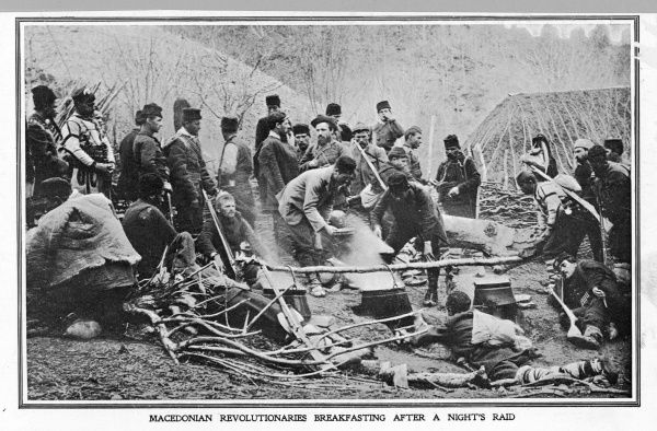 Macedonian revolutionaries have another go at throwing off Turkish rule : these rebels are breakfasting after a night's raid