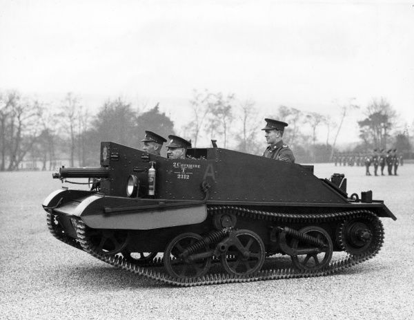 Machine gun carrier no. 2 with a Vickers machine gun, belonging to the 2nd Battalion Cheshire Regiment, during the First World War. Seen here on a parade ground. Date: 1914-1918