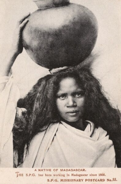 Madagascar - A young Girl carrying a large round jar on her head Date: circa 1908