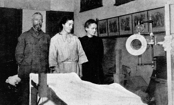 Photograph showing Marie Curie, discoverer of radium, visiting the British field-hospital at Furnes where she took X-rays of all cases
