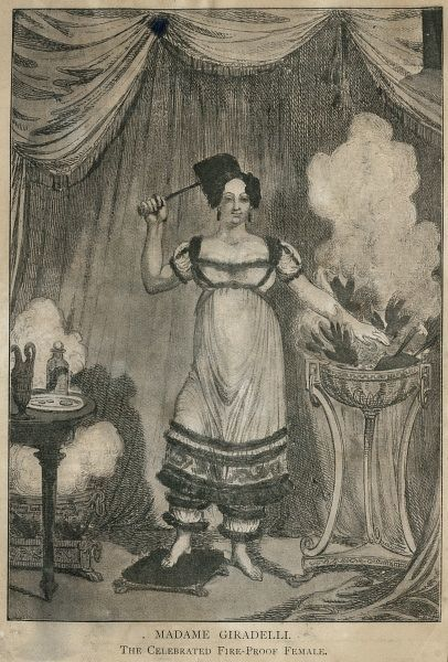"Undated illustration of Madame Giradelli, ""The Celebrated Fire-Proof Female"", with one hand in the brazier and foot on a slab of red-hot iron. HPG/8/2/1 (xxv)&quot"