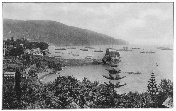 'A haven of rest in a world at war'. The British Atlantic fleet can also be seen here at anchor in the bay