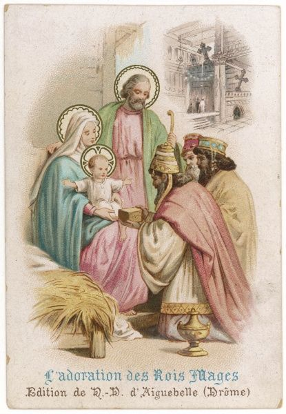 The three magi kneel in front of the baby Jesus, presenting him with his birthday presents
