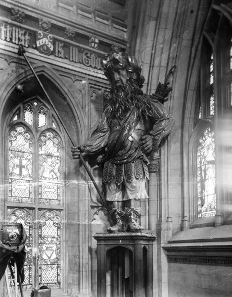 A statue of Magog, who along with fellow giant Gog, is a traditional mythical guardian of the City of London. Statue in the Guildhall, London. Date: 1980s