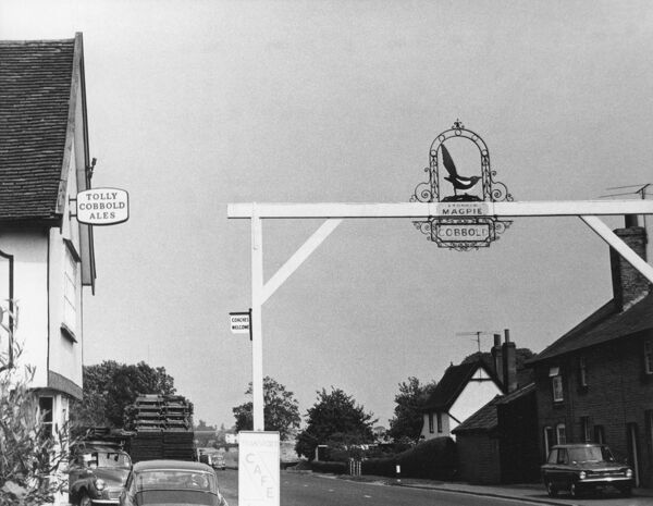 The novel inn sign of 'The Magpie Inn', Little Stonham, Suffolk, England. This is unique as being one of the few in England which stretches right across a public highway. Date: 1960s