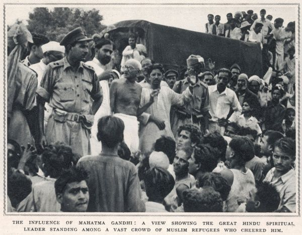 The hindu spiritual leader Mahatma Gandhi receives a warm reception from Muslim refugees gathered at a camp close to Delhi, prior to convoy travel to Pakistan. This image is a striking example of the hold Gandhi held in the minds of all Indians