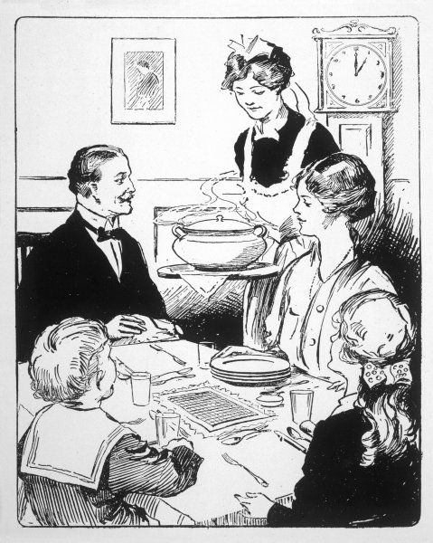 Family sits round the table while the maid brings round the lunch