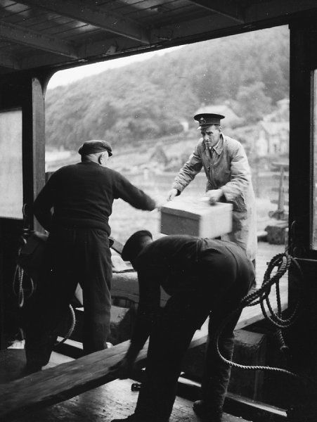 Loading mail boxes onto the steamer at the Kyles of Bute, Argyllshire, Scotland