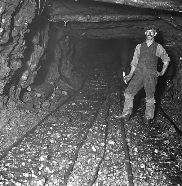 A miner stands alongside the main haulage track or 'road' at Tirpentwys Colliery, near Pontypool in South Wales