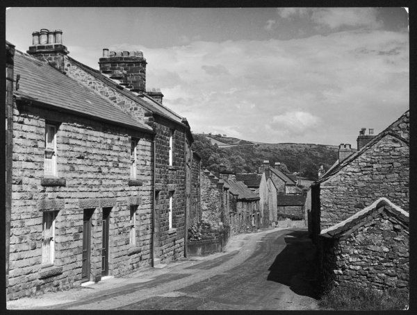 The main street of the village of Eyam, Derbyshire, famed for the Great Plague which visited it in 1665-6 when five sixths of the population died