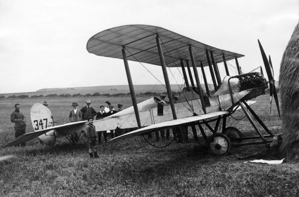 Major Hubert Dunsterville Harvey-Kelly (1891-1917), World War I pilot credited with being the first British pilot to land in France after the declaration of war. Seen here (right) studying a map in front of his BE2A 70 hp Renault engine aeroplane
