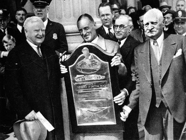 Sir Malcolm Campbell receiving a presentation from the people of Daytona after setting the land speed record at Daytona Beach in his 'Blue Bird', touching 281 miles per hour. The presentation was made at the Capitol in Washington by John N