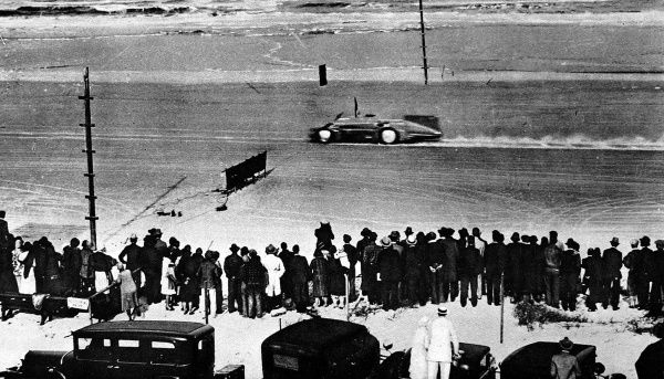 Photograph showing Malcolm Campbell in his 'Blue Bird II' setting the new world land speed record of 245.736 miles an hour, at Daytona beach, Florida
