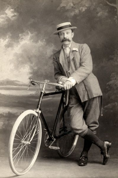 A man with his bicycle in the studio Date: c. 1910