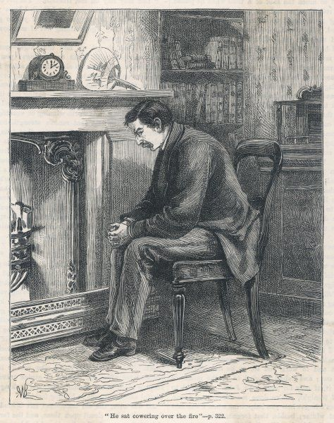 A man cowering in a pensive mood