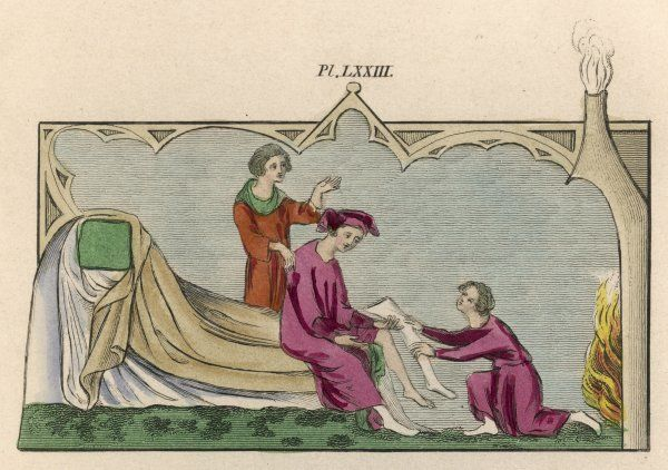 An English nobleman dressing, with the help of his two servants