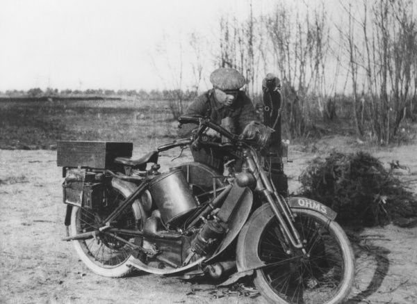 A man belonging to a Motorcycle Machine Gun Unit with a Scott motorcycle during the First World War. Date: March 1915