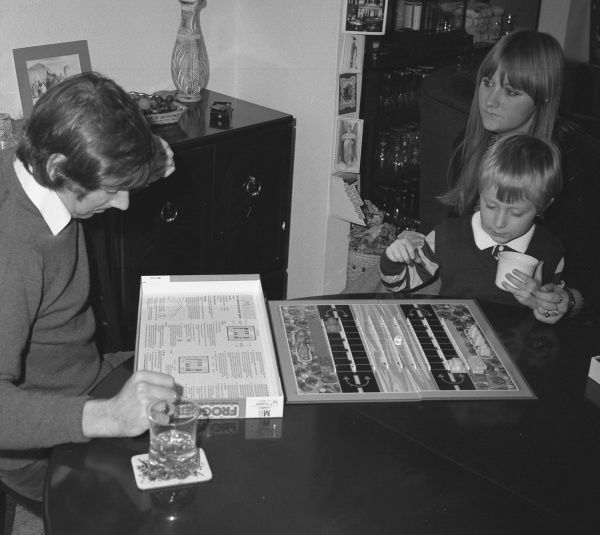 A man reading the rules of the board game Frogger, which was based on the popular arcade and video game of the same name and was brought out by Milton Bradley in 1981. The board game version is for two players, who are allocated their own supply of frogs