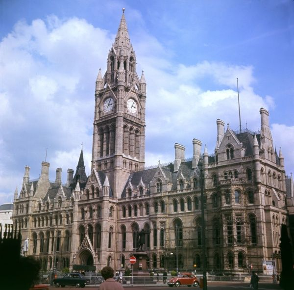 Manchester Town Hall, England, was completed by architect Alfred Waterhouse in 1877. It is a fine example of Victorian Gothic Revival and has murals by Ford Madox Brown. Date: 1967