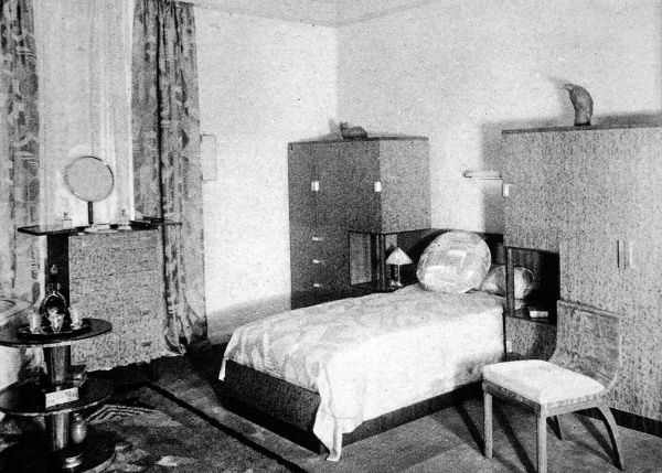 A man's bedroom; masculine straight lines with furniture of mahogany and lubinga. The new British furniture, a complete home in the modern manner. An exhibition at Waring and Gillow, the famous furniture house on Oxford Street