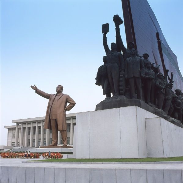 A giant statue of Kim Il Sung (1912-1994), communist leader of North Korea, with a depiction of revolutionary peasants and workers on the right, known as the Mansudae Grand Monument, located at Mansu Hill, Pyongyang, capital of North Korea