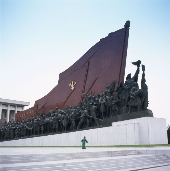 Depiction of revolutionary peasants and workers, part of the Mansudae Grand Monument, located at Mansu Hill, Pyongyang, capital of North Korea