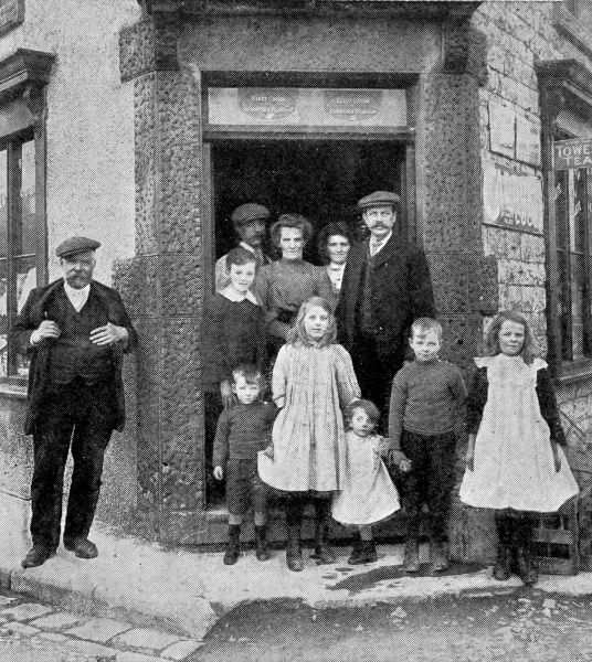 Photograph of the Marchington family outside the Post Office which they ran in Dove Holes, Derbyshire, 1913